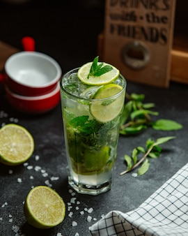 Mojito with lemon, mint and ice cubes.