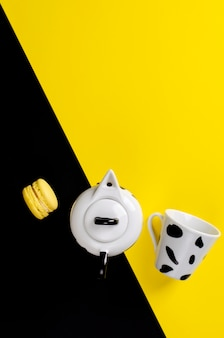 Moka coffee pot. italian coffee maker with a cup and macaroon on yellow and black