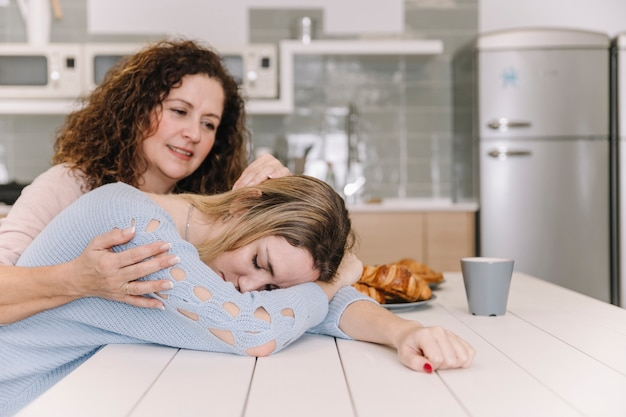 Mom comforting tired daughter
