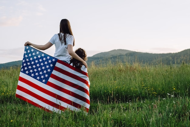 Mom and cute little daughter with american flag