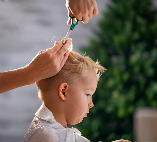 Mom cuts son's hair at home
