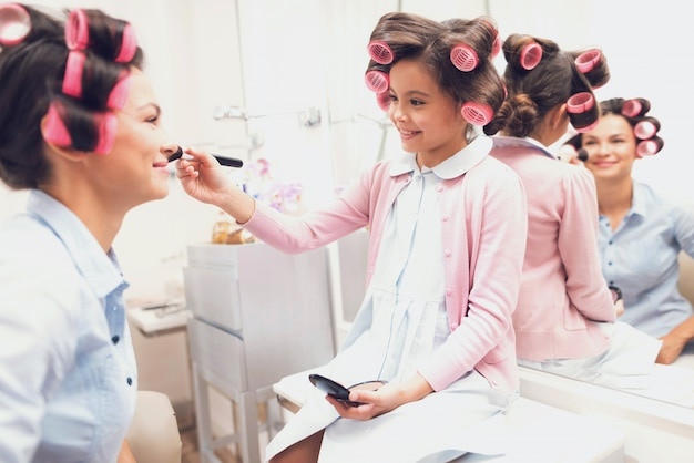 Mom and daughter in beauty salon together