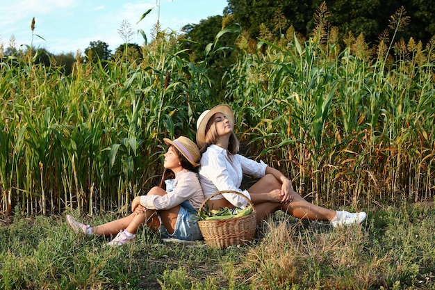 Mom and daughter in a corn field