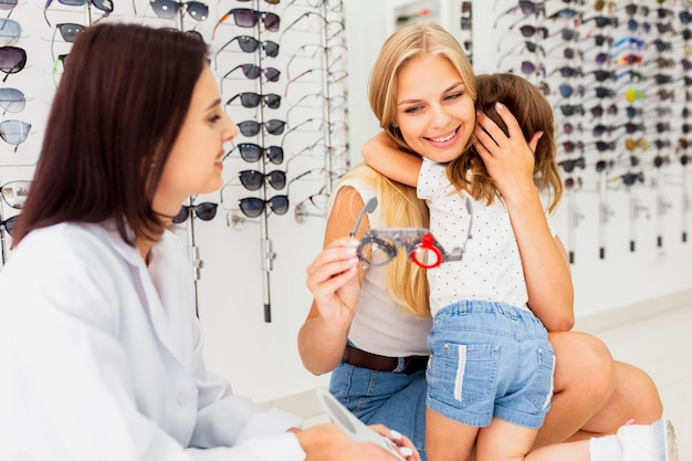 Mom and daughter at eye examination