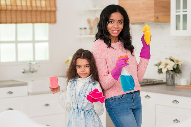 Mom and daughter at home cleaning