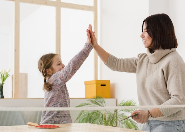 Mom and daughter making high five