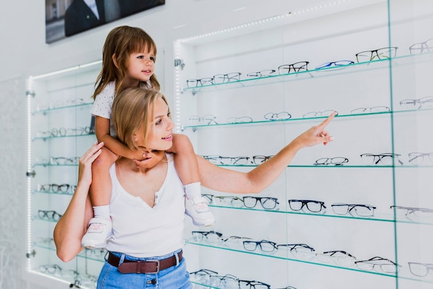 Mom and daughter at optician shop