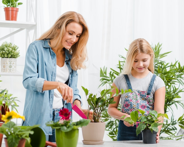 Mom and daughter planting flowers