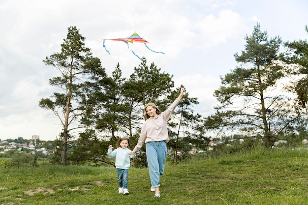 Mom and daughter playing with kite