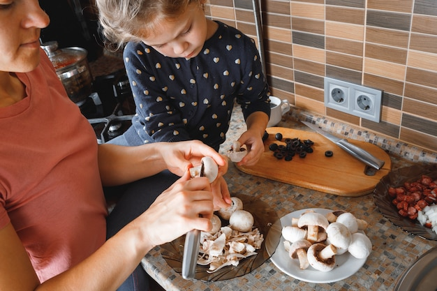 Mom and daughter prepare in the kitchen. the concept of a healthy diet and lifestyle. family value.