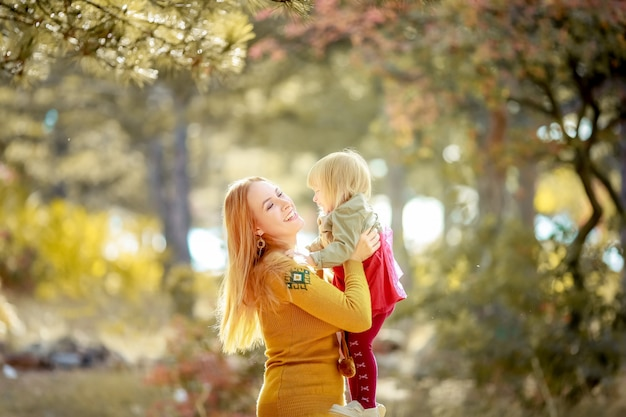 Mom and daughter on a walk in the park