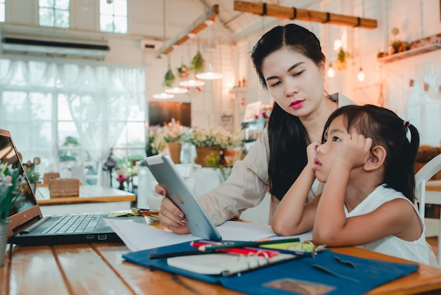 Mom forces children to do homework and study online at home