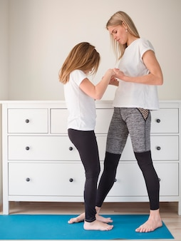 Mom and girl exercising