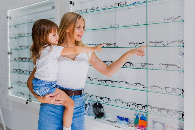 Mom and girl at optician shop