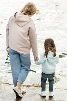 Mom and girl walking together