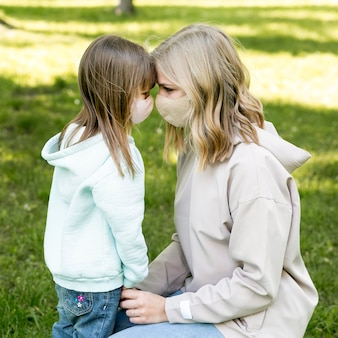 Mom and girl wearing medical mask