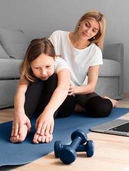 Mom and girl working out