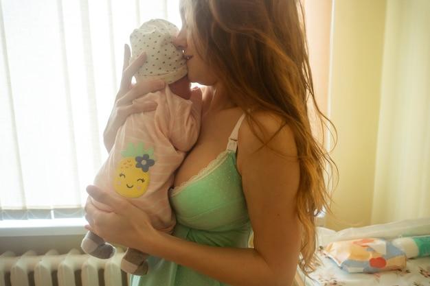 Mom and her little newborn baby girl