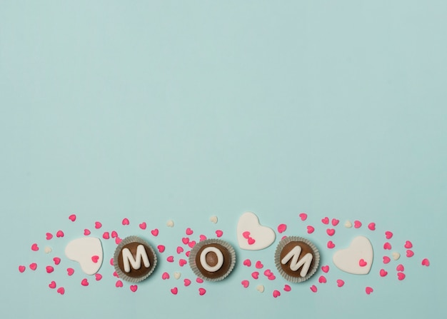 Mom inscription on set of candies between decorations