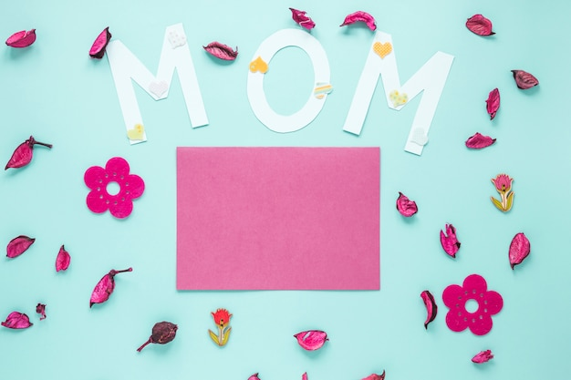 Mom inscription with paper and flower petals