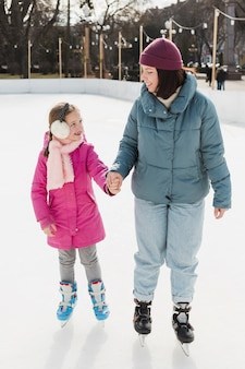 Mom and kid ice skating