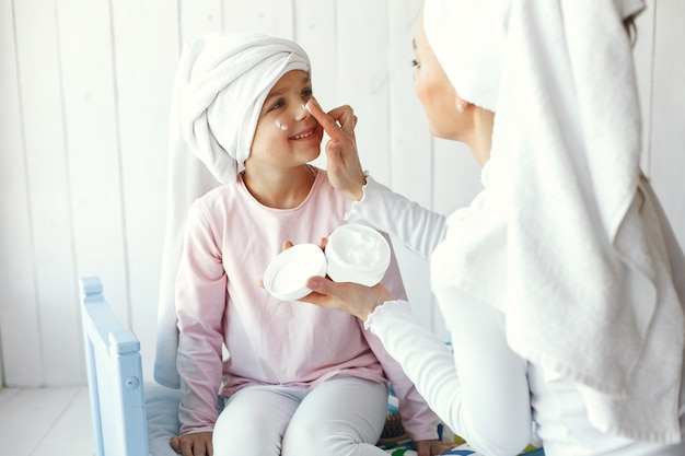 Mom playing with cosmetics with her daughter