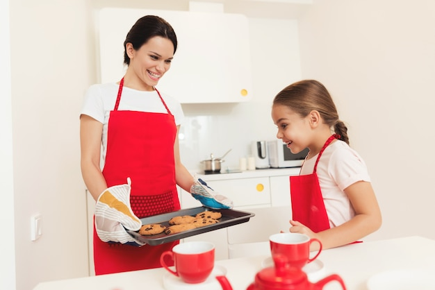 Mom shows little girl what they cooked.
