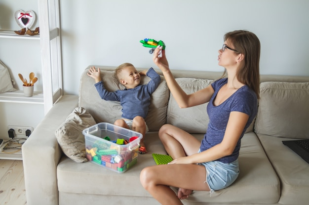 Mom and son playing together, building block toys