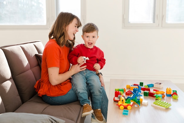 Mom and son playing with toys