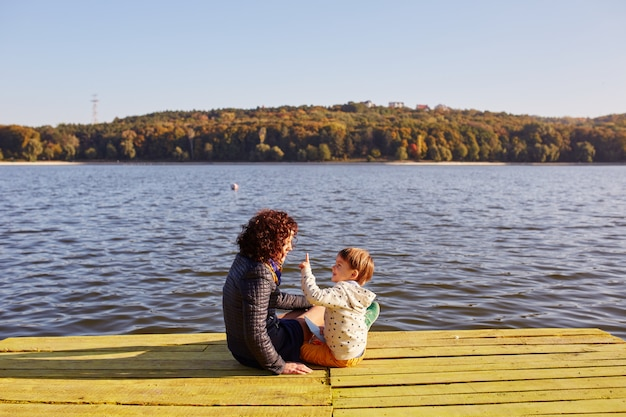 Mom and son resting by the lake