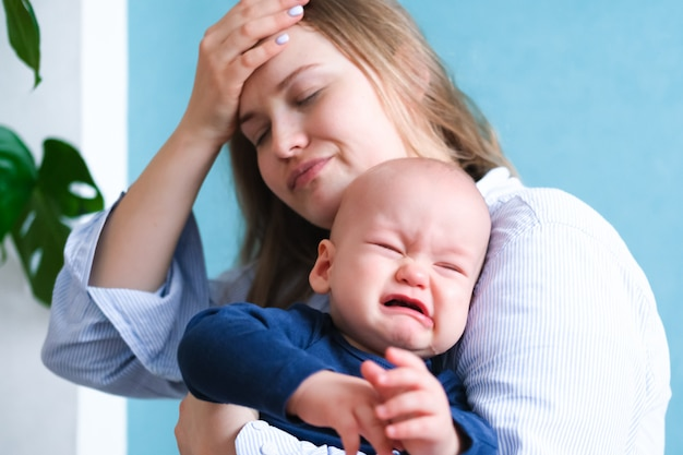 Mom tired trying to calm her crying baby