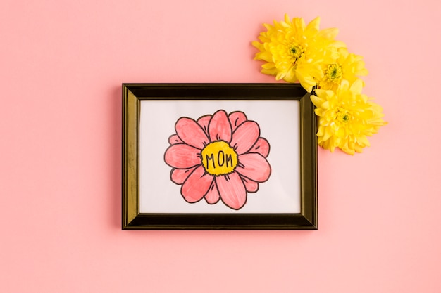 Mom title on painting in photo frame with flower buds