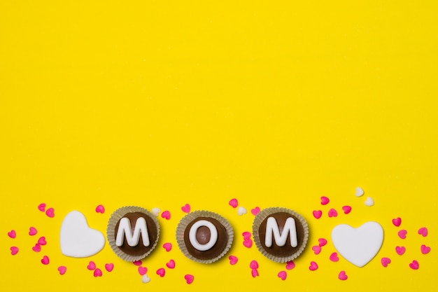 Mom title on sweet candies between decorations
