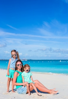 Mom and two little girls during beach vacation