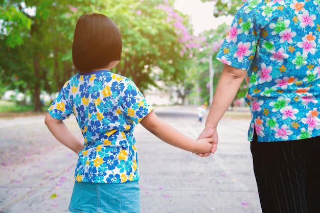 Mom walked in hand in the park.