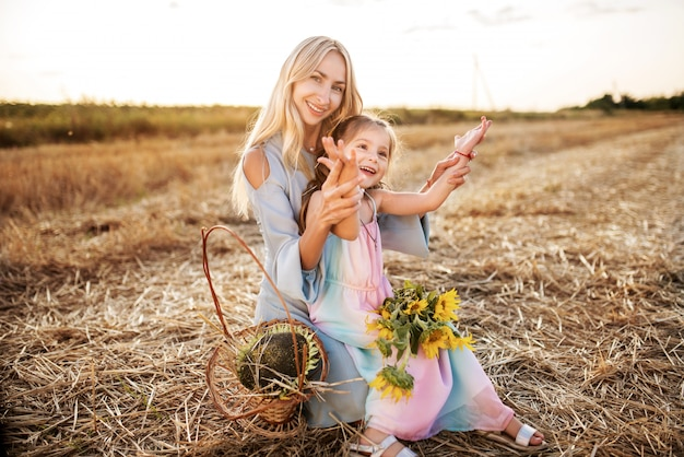 Mom walks and plays with pretty little daughter