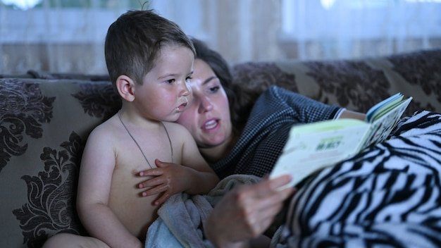 Mom with a child reading a book