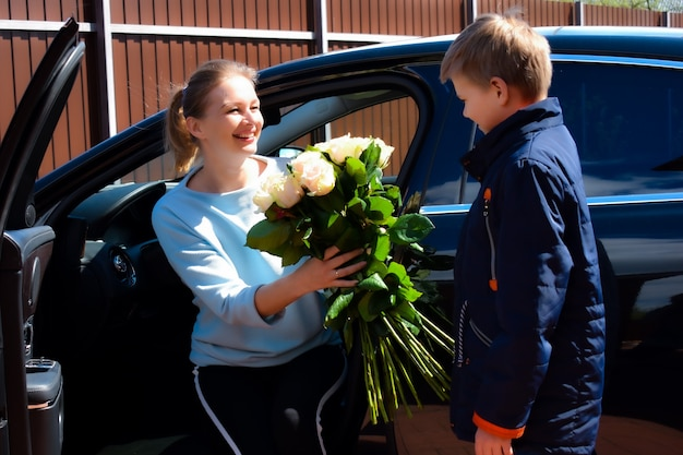 Mom with son and flowers.