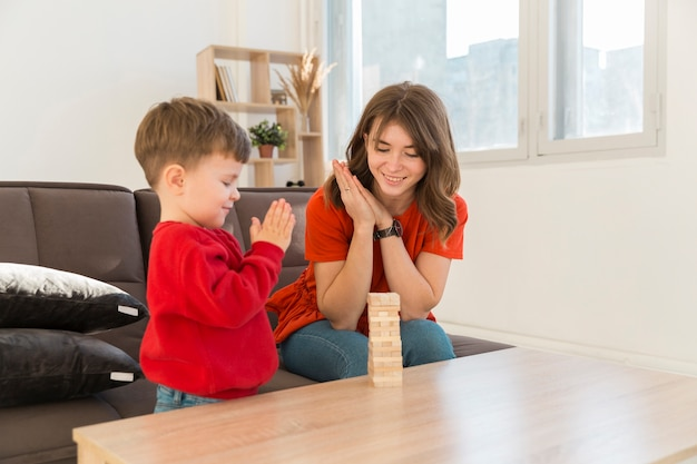 Mom with son playing janga game