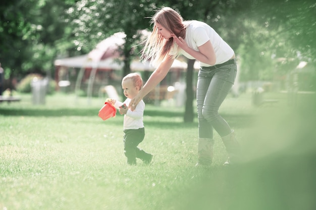 Mommy and her little son on a walk in the city park. the concept of active recreation