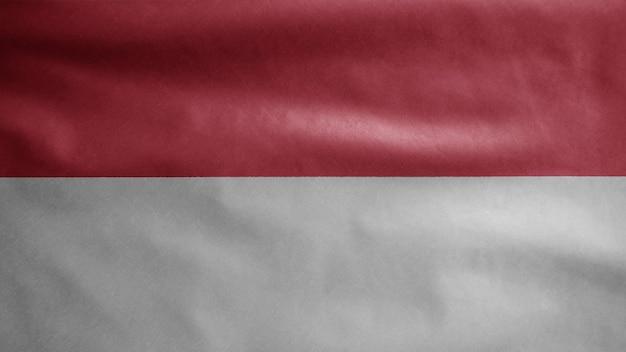 風に揺れるモナカンの旗。モナコのバナー吹くと滑らかなシルクのクローズアップ