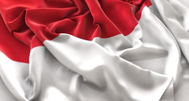 Monaco flag ruffled beautifully waving macro close-up shot