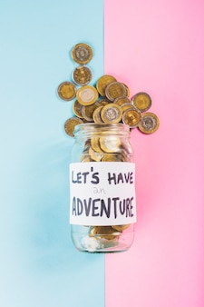 Money for adventure in jar