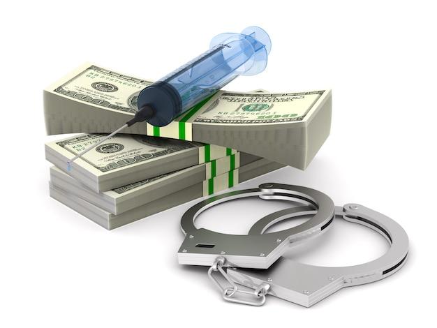 空白のお金と注射器と手錠