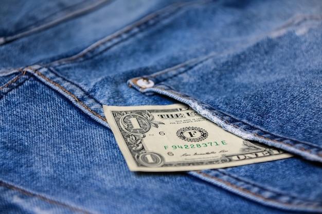 Money in back blue jeans pocket denim