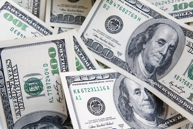 Money background from 100 dollar bills.  payment, savings, budget, earnings, finance concept