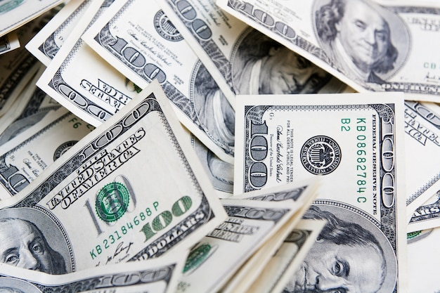 Money background from notes for 100 dollars.  payment, savings, budget, earnings, finance concept