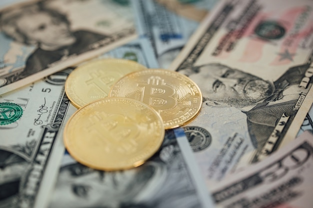Money background. usa dollar with euro banknotes and bitcoin cryptocurrency investing concept.