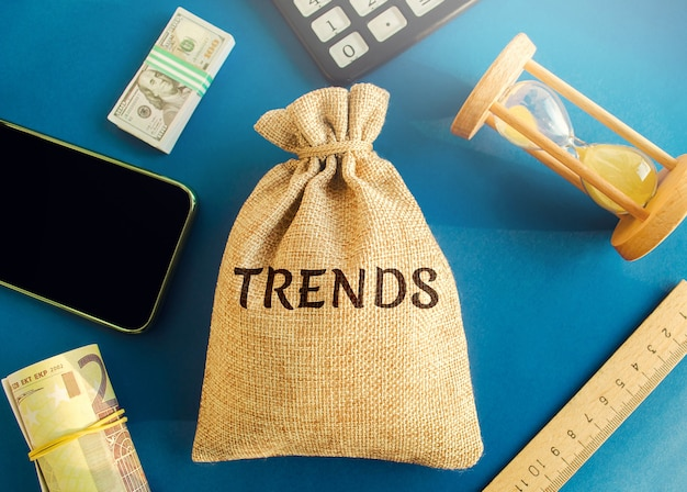 Money bag with the word trends popular and relevant topics new ideological trends