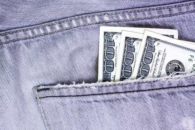 Money cash currency in jeans pocket